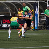 Gemma Etheridge with the ball is tackled by Claudia jaqueline Lopes Teles