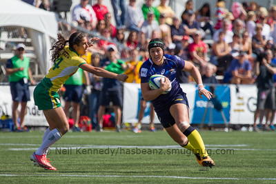 Sharni Williams with the ball evading a tackle