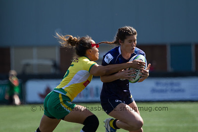 Charlotte Caslick is tackled by Paula Harumi Ishibashi