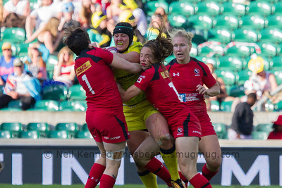 Britt Benn and Natasha Watcham-Roy tackle Sharni Williams