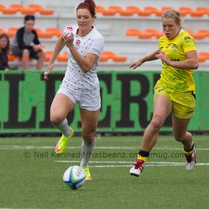 Jo Watmore (England) and Emma Tonegato (Australia) compete for the ball
