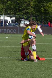 Chloe Dalton is tackled by Ghislaine Landry