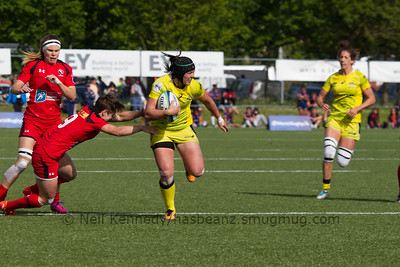 Sharni Williams is tackled by Ghislaine Landry