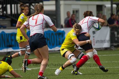 Yulia Ledovskaya moves to support Anna Prib as she is tackled by Nicole Beck