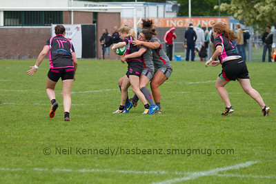 Tackled by Ffion Bowen and Shona Powell-Hughes
