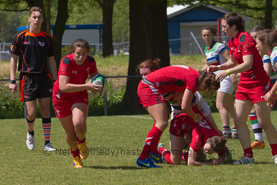 Sioned Harries heads away from the breakdown with the ball