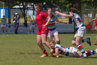 Katie Mason tackles Sioned Harries