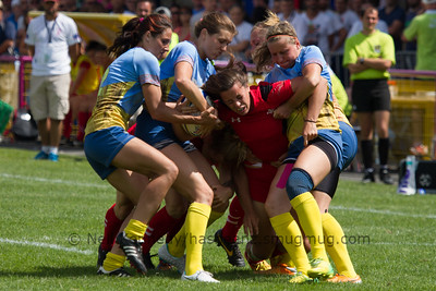 Sioned Harries is tackled by four of the Ukraine Sevens team