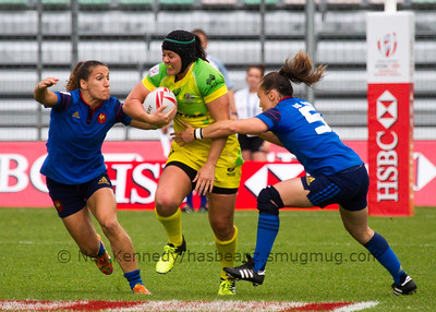 Australia 7s Sharni Williams is tackled by France's Fanny Horta and Jade Le Pesq