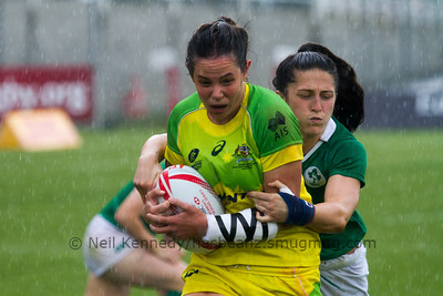 Australia 7s Chloe Dalton with the ball is tackled by Ireland's Lucy Mulhall