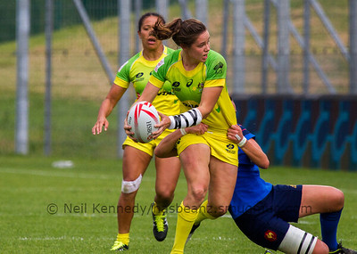 Australia 7s Chloe Dalton looks for an offload as she is tackled