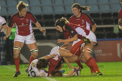 Stéphanie Bernier with the ball is tackled and Kayla Mack covers so the ball can be recycled
