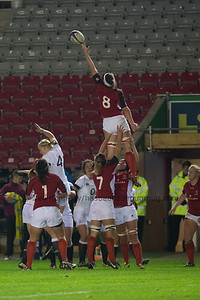 Jacey Murphy reaches at the lineout supported by Kayla Mack (front) and Kelly Russell (7)