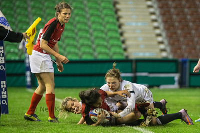 Magali Harvey with the ball is tackled by Lydia Thompson