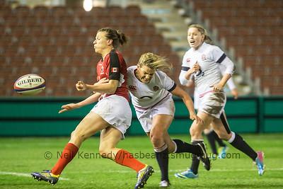 Abi Chamberlain tackling Julianne Zussman as she offloads