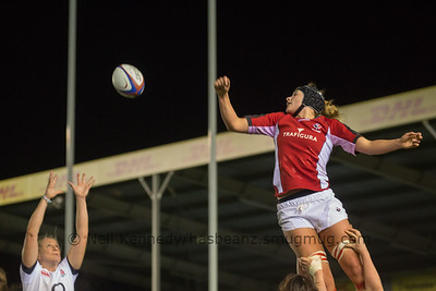 Kayla Mack looks ove rher shoulder as Tamara Taylor rises to catch the ball
