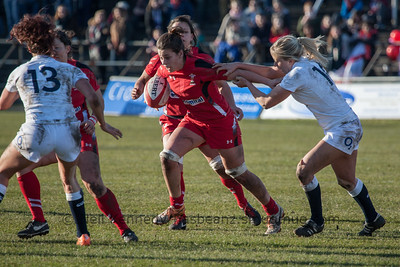 Sioned Harries tries to break a tackle by Ceri Large.