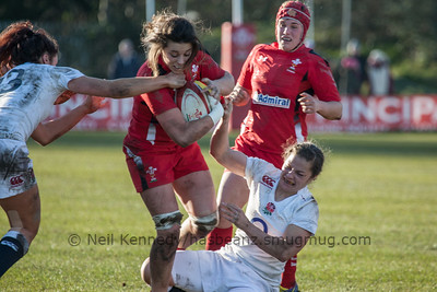 Emma Croker and Abigail Brown tackle Sioned Harries