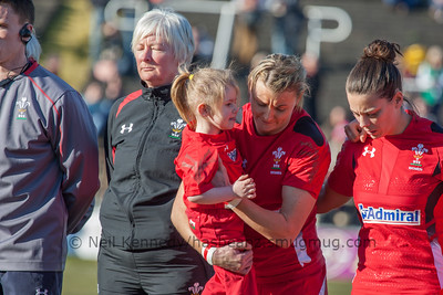 Wales captain Rachel Taylor with the Wales mascot before the game.