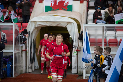 Rachel Taylor leads out the Welsh team