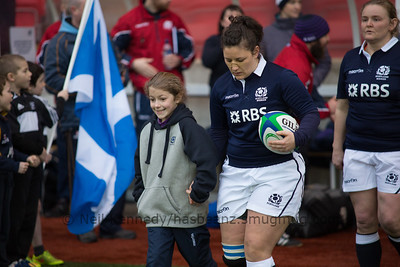 Tracy Balmer leads the Scots team and mascot out for the anthems.