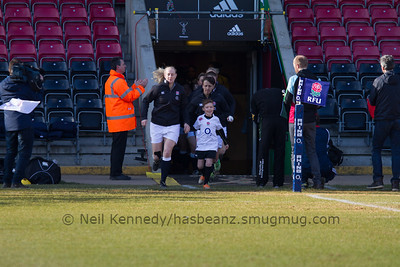Tamara Taylor leads out the England Ladies team with the mascot.