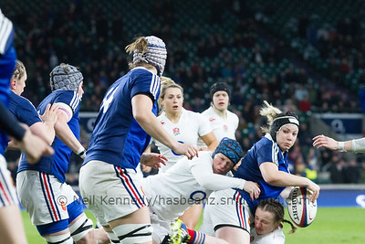 Patricia Carricaburu offloads as she is tackled by Rochelle Clark and Hannah Field