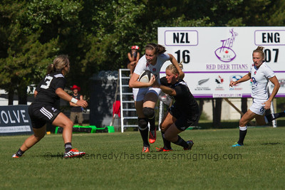 Emily Scarratt with the ball is tackled by Chelsea Alley