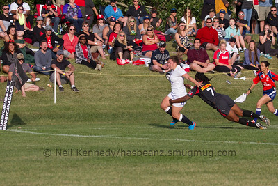 Amy Cokayne pushes through the tackle