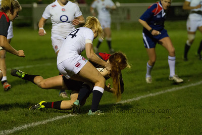 Alex Tessier driving through Holly Myer's tackle to score