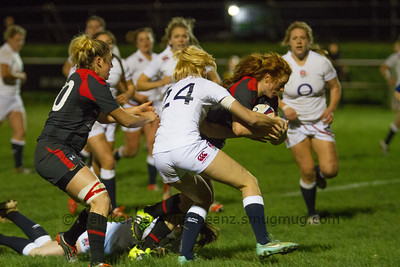 Alex Tessier driving through Holly Myer's tackle