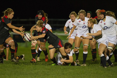 Chelsea Guthrie with the ball, offloading to Katie Svoboda