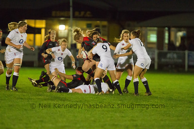 Tyson Beukeboom with the ball is tackled by Bianca Blackburn