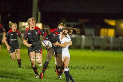 Emma Jada drives through a tackle by Rachel Lund