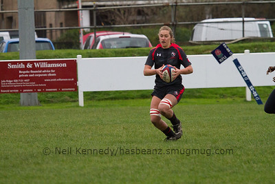 Katie Svoboda with the ball scoring a try