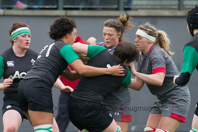 Alisha Butchers is tackled by Sophie Spence and Ciara Griffin