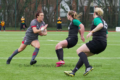 Bethan Dainton advances with the ball as Elise O'Byrne White and Niamh Briggs close to tackle