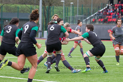 Rebecca Rowe is tackled by Paula Fitzpatrick