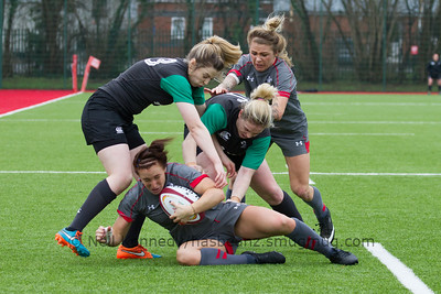Bethan Dainton with the ball is tackled by Niamh Briggs and Aine Donnelly as Adi Tavinier closes in to support her.