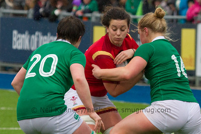 Double tackle in the rain on Sioned Harries by Ciara Griffin and Cliodhna Moloney