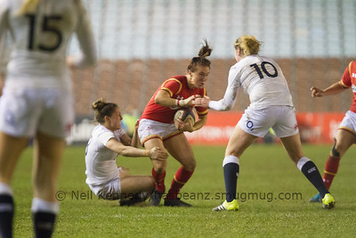 Bethan Dainton is tackled by Lauren Cattell