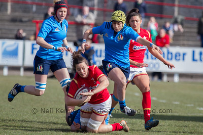 Sioned Harries (Whitland /Scarlets) with the ball is tackled