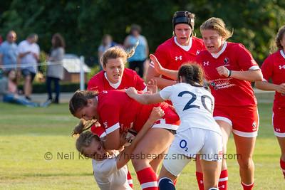 Veronica Harrigan drives into an English tackle