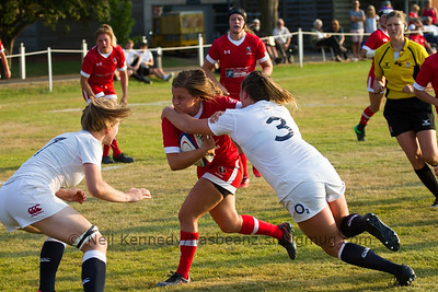 Justine Pelletier (Club de Rugby de Quebec), Quebec City, QC advances with the ball and is tackled by Sarah Bern