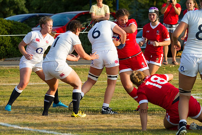 Veronica Harrigan wrestles for the ball in contact with Sally Stott