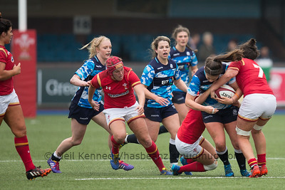 Lisa Thomson drives forward and is tackled by Sioned Harries