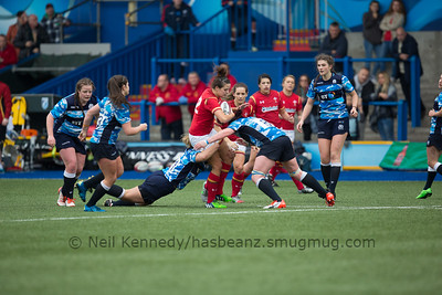 Jodie Evans ball in hand is double tackled