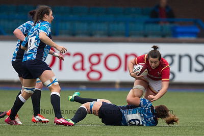 Sioned Harries is tackled by Jemma Forsyth
