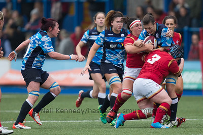 Louise McMillan is tackled by Meg York and Siwan Lillicrap