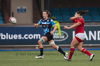Rebecca De Filippo pases the ball as Louise McMillan drifts